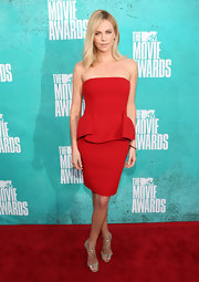 Oh Charlize, you never let us down on the red carpet. This red peplum Lanvin dress was brilliantly simple, particularly with the actress' effortless 'do and minimalist approach to accessorizing.