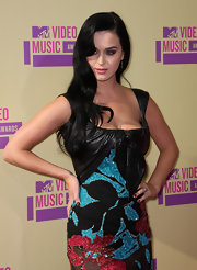 Katy styled her hair in dark side-swept curls for the MTV VMAs.