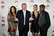 Tia Carrere complemented her neutral outfit with a red crocodile clutch at the 2012 Miss USA Pageant.