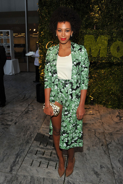 Solange Knowles arrived at the MoMA Garden Party Benefit wearing neutral blade heels with her vivid green suit.