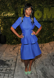 Santigold matched the refreshing shade of her shoes to her nail lacquer and eyeliner.