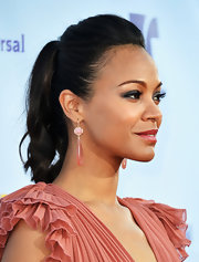Zoe wore her hair in a sleek yet voluminous ponytail on the ALMA red carpet.
