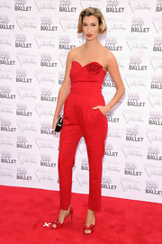 It takes a bold gal to rock a red fitted jumpsuit.