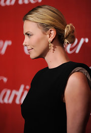 Charlize Theron wore her shoulder-length hair in a loose bun at the 2012 Palm Springs International Film Festival.