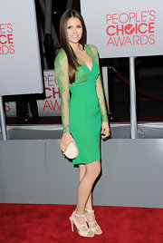 Nina Dobrev teamed her jade green Elie Saab number with an ivory oval clutch.