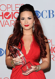 Demi Lovato added a touch of bright ruby red lipstick to her scarlet ensemble at the 2012 People's Choice Awards.