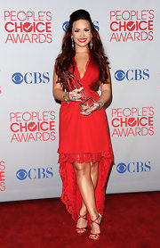 Demi added pep to her step with red satin strappy sandals.