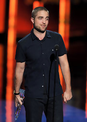 Robert Pattinson kept things casual at the People's Choice Awards in a navy short-sleeved button up.
