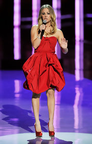 Kaley Cuoco opted for a strapless red cocktail dress paired with ruby-red satin slingbacks.