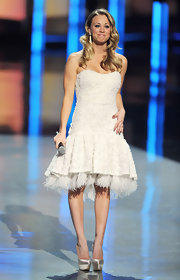 Kaley Cuoco dazzled in white onstage at the 2012 PCA. She paired her fabulously feathered outfit with silver satin platform pumps.