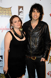 Sophie Simmons added a glamorous statement necklace to her plain black outfit.
