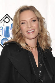 Uma Thurman added a lot of pretty spiral curls to create an ultra-feminine look at the 2012 Room to Grow fundraising gala.