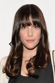 Liv Tyler added some soft curls to her lengthy locks and wore her bangs sleek and straight at the 2012 Room to Grow fundraising gala.