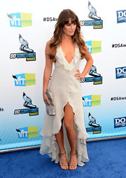 Lea Michele paired a provocative ruffle dress with strappy high-heeled sandals.