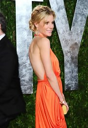 Julie Bowen accented her vivid orange dress with a stunning rock crystal bracelet in 18-carat yellow gold with diamonds for the 2012 'Vanity Fair' Oscar Party.
