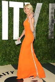 For the Vanity Fair Oscar after-party, Cameron Diaz wore this long zip-up orange dress.