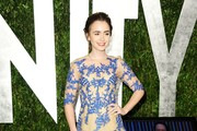 Actress Lily Collins arrives at the 2012 Vanity Fair Oscar Party hosted by Graydon Carter at Sunset Tower on February 26, 2012 in West Hollywood, California.