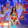 2012—Joan Smalls Looks Fierce in Tiger Print and Flames
