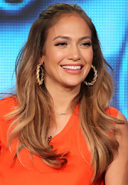 Jennifer Lopez attended the 2012 Winter TCA Tour wearing her golden brown tresses in loose waves.