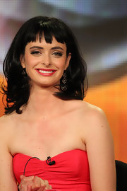 Krysten Ritter wore her dark hair in shiny voluminous waves with short blunt bangs during the 2012 Winter TCA Tour.
