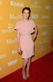 Cobie Smulders looked pretty in pin in this ruffle-shouldered blush-pink frock.