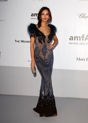 Madalina Ghenea stepped out at the amfAR Cinema Against AIDS event wearing an elegant floor-length sequined gown with a fur collar.