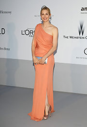 Kelly Rutherford arrived for the amfAR Cinema Against AIDS event wearing a pair of muted copper satin peep toe pumps.