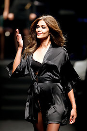 Ana Beatriz Barros looked seductive at the amfAR fashion show in a black silk robe.