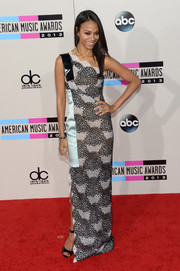 Zoe Saldana chose a printed one-shoulder gown by Roland Mouret for her American Music Awards red carpet look.