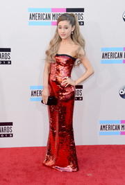 Ariana Grande went for a very mature look with this sequined red strapless gown by Dolce & Gabbana at the American Music Awards.
