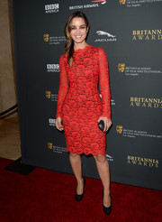 Berenice Marlohe looked sexy and ladylike at the same time in a tight-fitting red lace cocktail dress by Dolce & Gabbana during the BAFTA LA Britannia Awards.