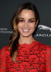 Berenice Marlohe styled her tresses in an edgy side sweep for the BAFTA LA Britannia Awards.