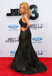 Lil Mama chose a flowing beaded black gown with a ruffled skirt for the 2013 BET Awards.