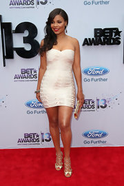 Sanaa Lathan wore this champagne-colored bandage dress at the BET Awards red carpet.
