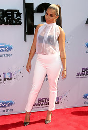 Lauren London showed a peek of her black bra with this sheer white blouse.