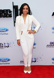 Mya opted for a sleek and contemporary red carpet look when she wore this ivory pantsuit that featured beading on the lapel.