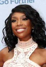 Brandy topped off her golden, dewy look with a super shiny clear lip gloss.