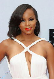 Letoya showed off her long chocolate-colored tresses with a side swept hairdo.