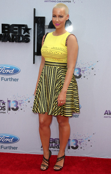 Amber Rose opted for a big and bold red carpet statement when she donned this yellow patterned dress.