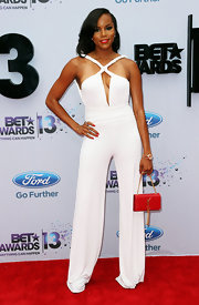Letoya Luckett sported a crisp white jumpsuit with a twisted halter neck.