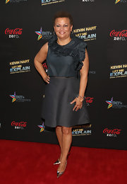 Debra Lee chose a ruffled sleeveless top for the 'Let Me Explain' premiere.