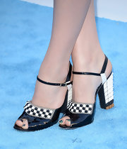Chloe Grace Moretz rocked a pair of black-and-white evening sandals that featured dot embellishments as well as studs on the heels.