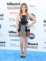 Chloe Grace Moretz opted for a cool patchwork-style mini dress that featured a white leather belt.