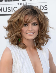 Stana Katic opted for high volume when she rocked a super-teased curly 'do.