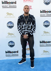 Chris Brown showed his versatile fashion sense in a mixed-print sweatshirt at the Billboard Music Awards.