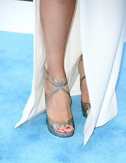Selena Gomez kept her shoes simple and chic with these silver and gold strappy sandals.