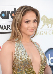 J. Lo looked glowing on the blue carpet for the Billboard Music Awards when she showed off her honey locks with a straight 'do.