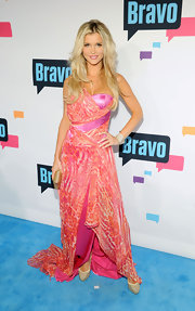 Joanna Krupa reminded us of a super-glamorous Amazon woman when she sported this bright pink animal-print dress featuring a one-shoulder strap and flowing skirt.
