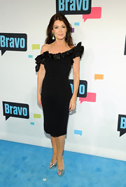 Lisa Vanderpump pulled off this LBD with an '80s-style ruffled neckline in only a way that Lisa Vanderpump can.