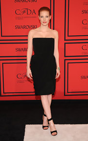 Jessica Chastain opted for minimal elegance with a strapless black corduroy dress that featured a chiffon detail draping on the front and back.